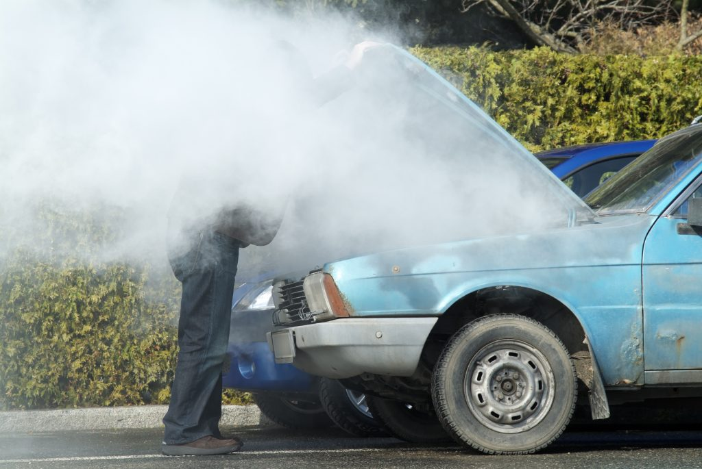Broken down vehicle spewing steam from the bonnet.